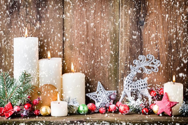Christmas Advent candles with festive decor.  royalty free stock image