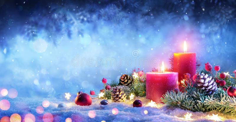 Christmas Advent - Red Candles With Ornament. On Snow royalty free stock image
