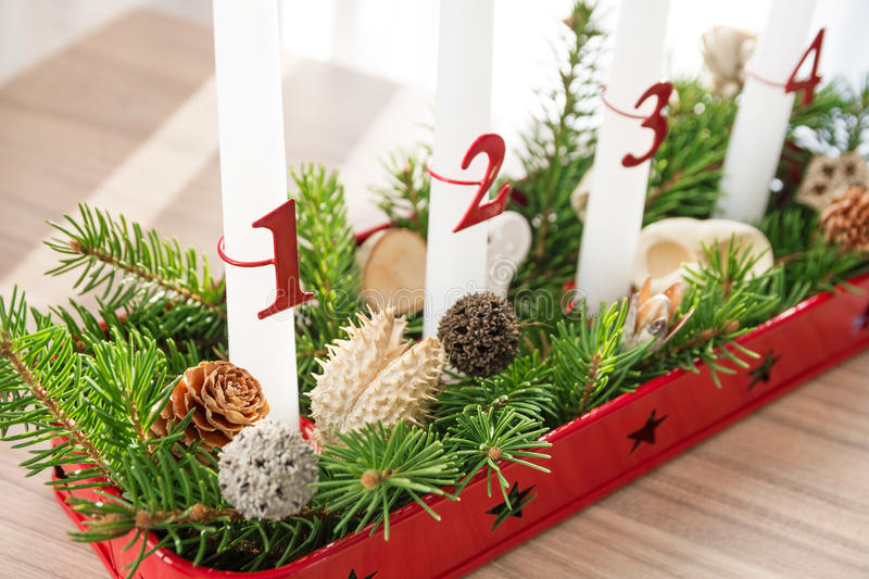 Christmas advent wreath on table, first advent in focus royalty free stock photos