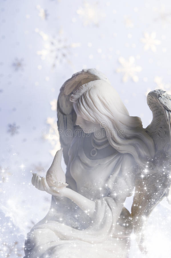 Christmas angel. A statue of Christmas angel over starry background royalty free stock images