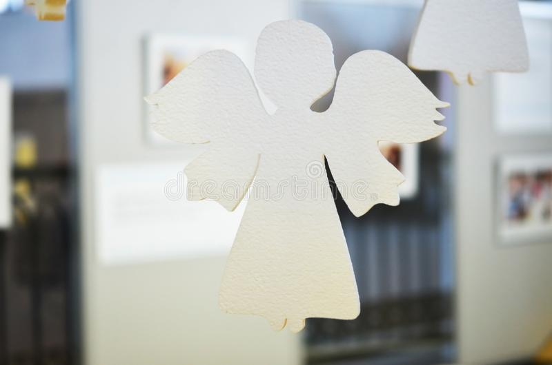 Christmas angel. Children`s Art Project, Cneedlework, crafts for children. stock photo
