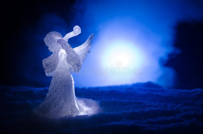 Christmas Angel glass xmas figure and glass fir tree, christmas tree, docorative elements on dark background. Christmas decoration stock images