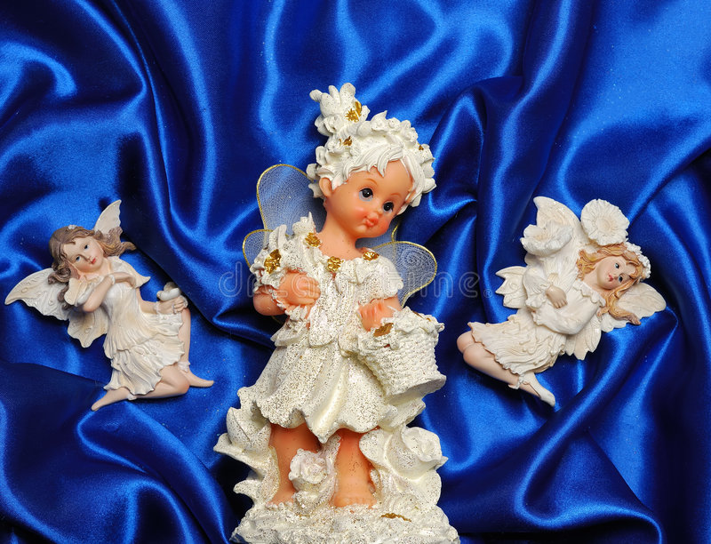 Christmas angels. Decorations on blue stuff stock photos