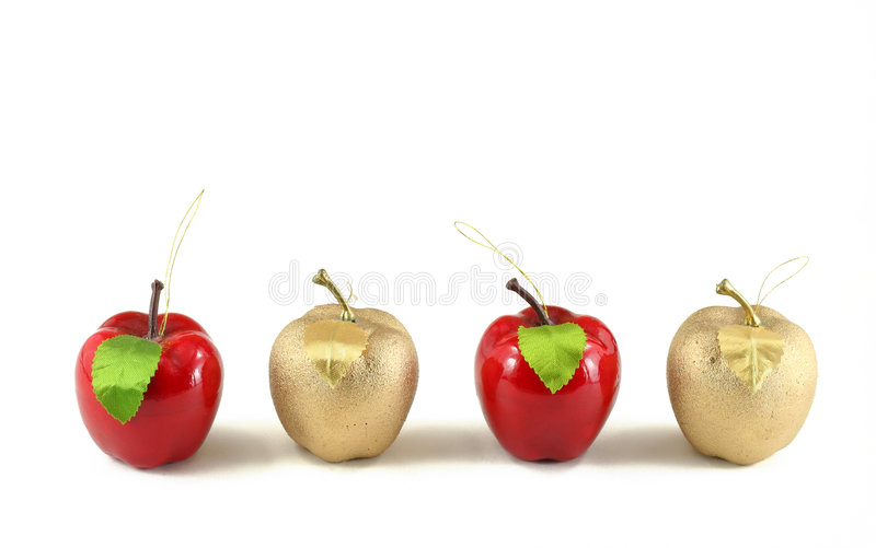 Christmas apples. Golden and red apples, hand made christmas decorations isolated on white royalty free stock images