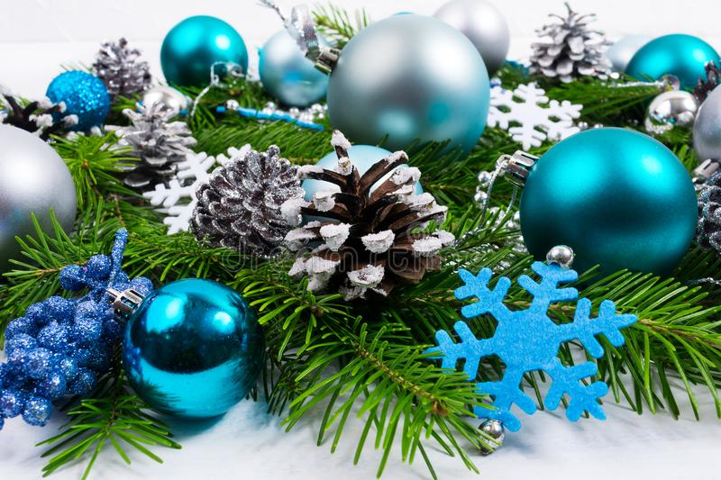 Christmas arrangement with blue snowflake, silver and turquoise stock images