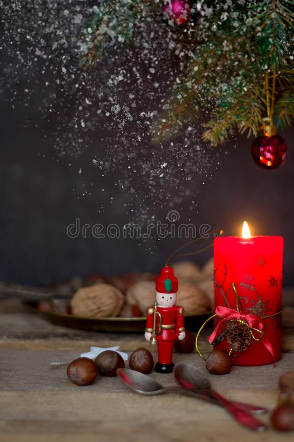 Christmas arrangement with a candle, fir branches and Christmas decorations stock photo