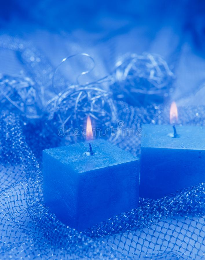 Christmas Ornaments. Two blue candles. stock images