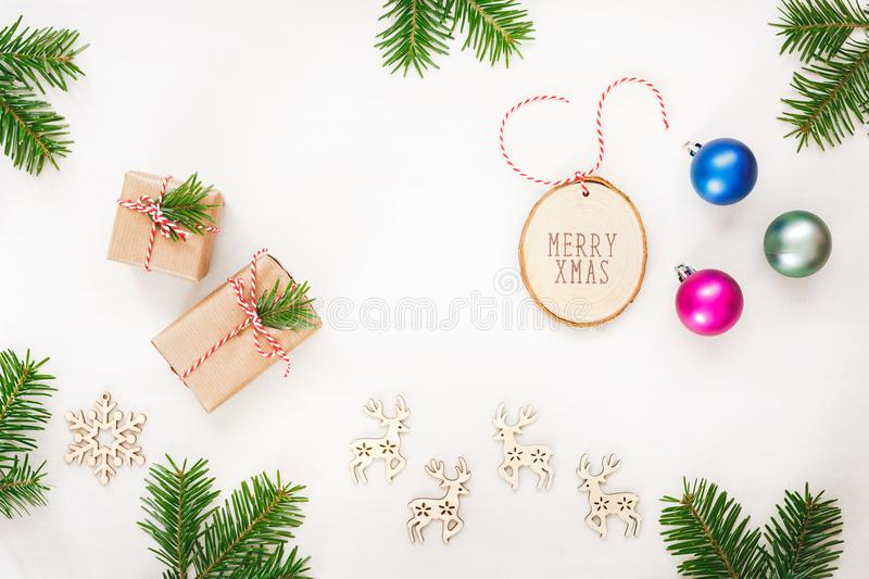 Christmas arrangement with presents, ornaments and natural pine twigs royalty free stock photography