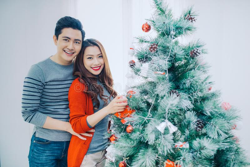 Christmas Asian Couple.Happy Smiling Family at home celebrating. stock photo