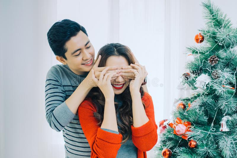 Christmas Asian Couple.Happy Smiling Family at home celebrating. royalty free stock photo