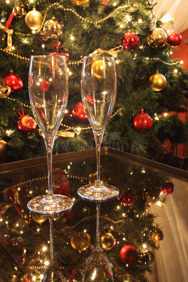 Christmas atmosphere. With tree and wineglasses royalty free stock image