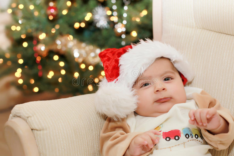 Christmas baby. Baby boys very first Christmas stock photos