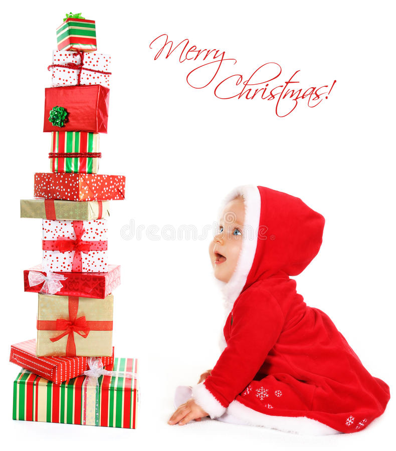 Christmas baby with gifts royalty free stock photos