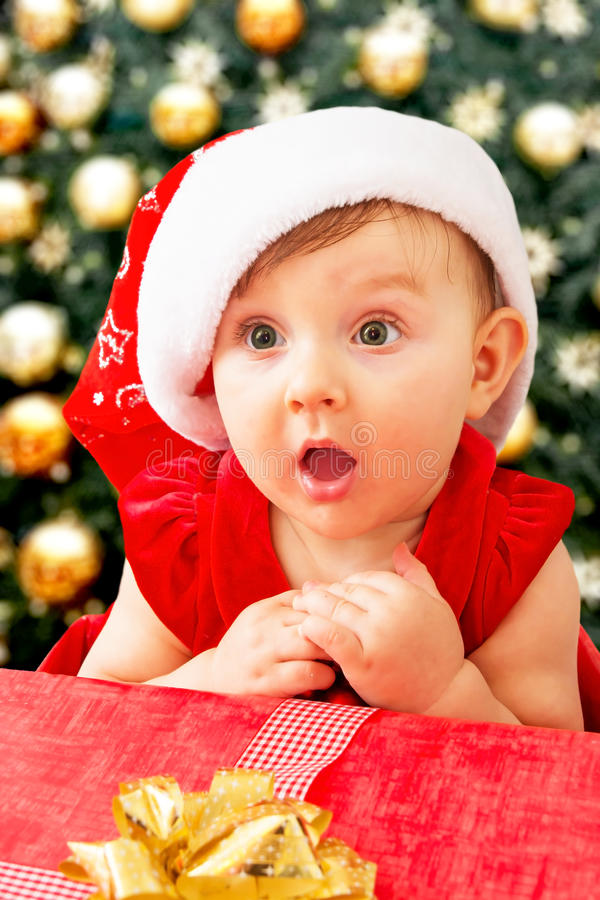 Free Christmas Baby Girl And Present Stock Photo - 83124860