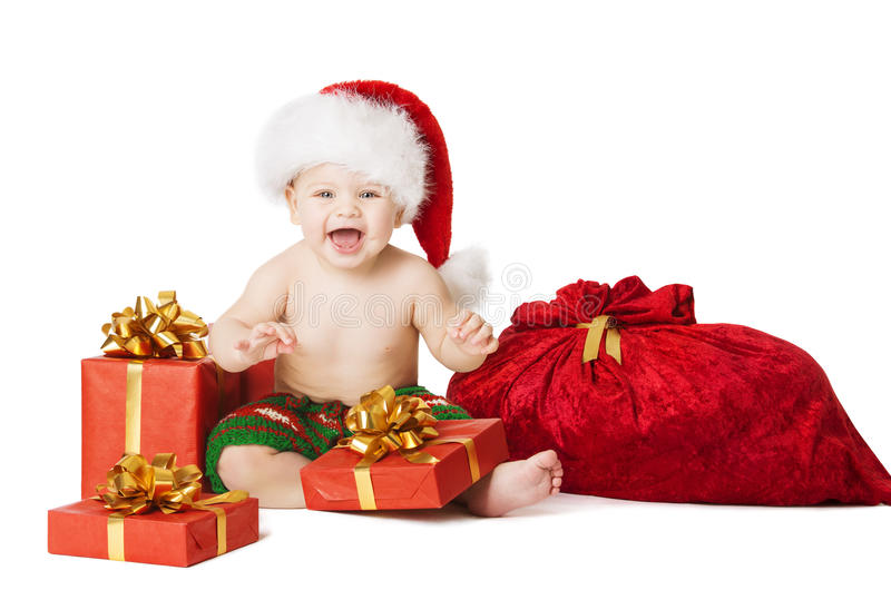 Christmas Baby Kids, Child Present Gift Box And Santa Bag. Christmas Baby Kids, Present Gift Box And Santa Bag, Child Happy Smiling In Red Hat With Xmas Sackful