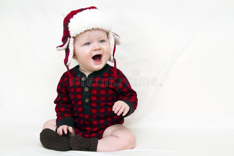 Christmas baby with red shirt and hat royalty free stock images