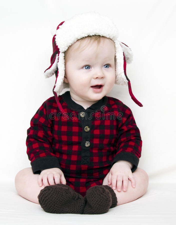 Christmas baby with red shirt and hat stock photos