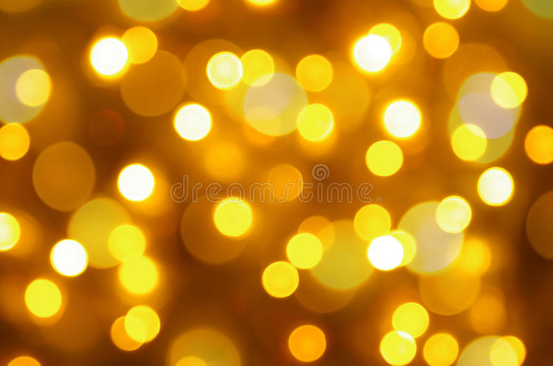 Christmas background. Glowing yellow Christmas lights background with copy space