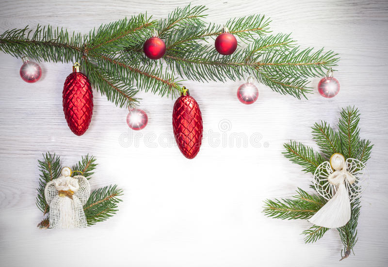 Christmas background with angels and glass balls on fir. Christmas background with angels and glass balls on fir stock image