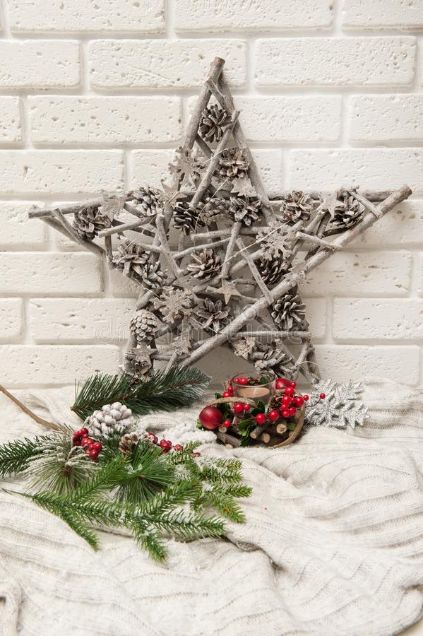 Christmas background with artificial snow, star, and Christmas tree branches stock image