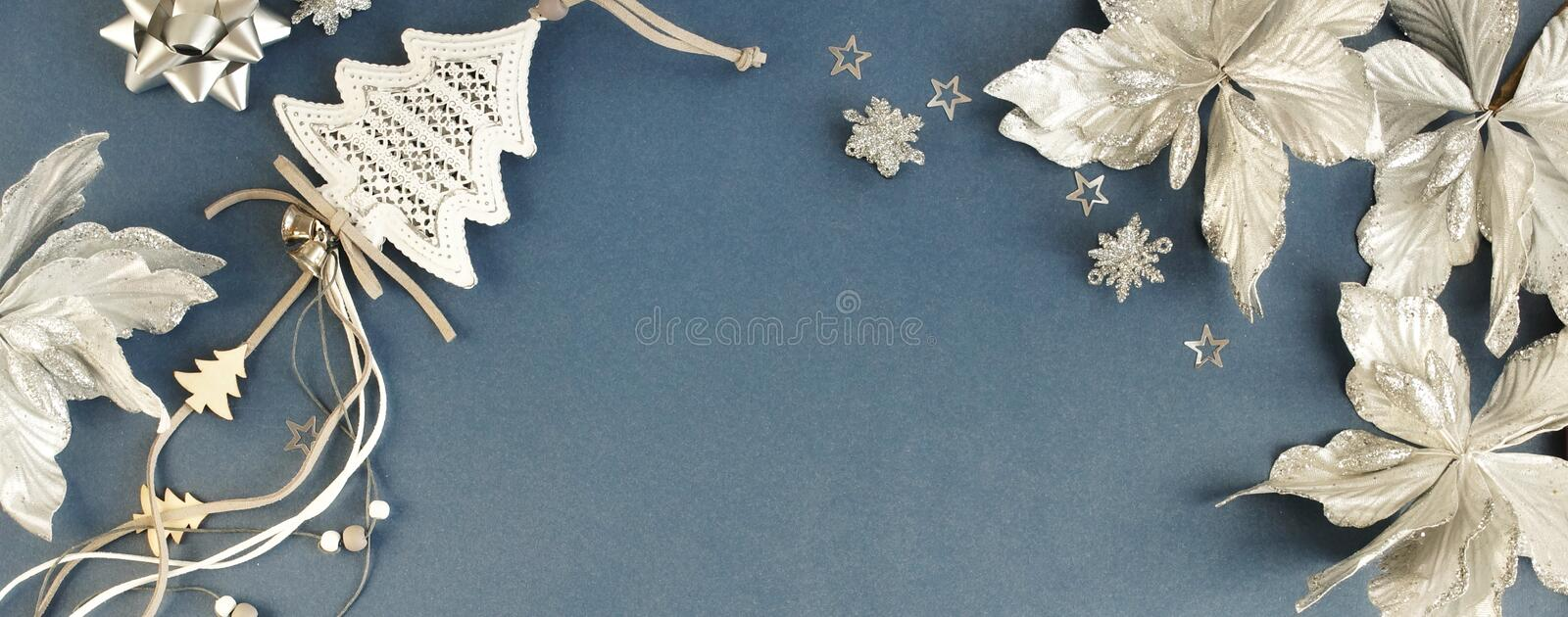 Christmas background banner. Xmas or new year white silver color decorations on blue gray  background with empty copy space for te royalty free stock image