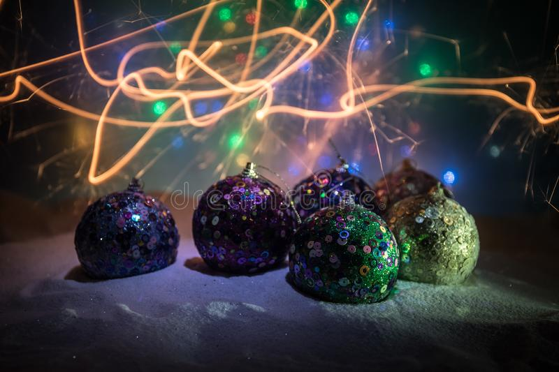 Christmas background with baubles, on snow, free space for text. Christmas decoration. Winter holidays concept. Christmas background with baubles, on snow, free stock photo