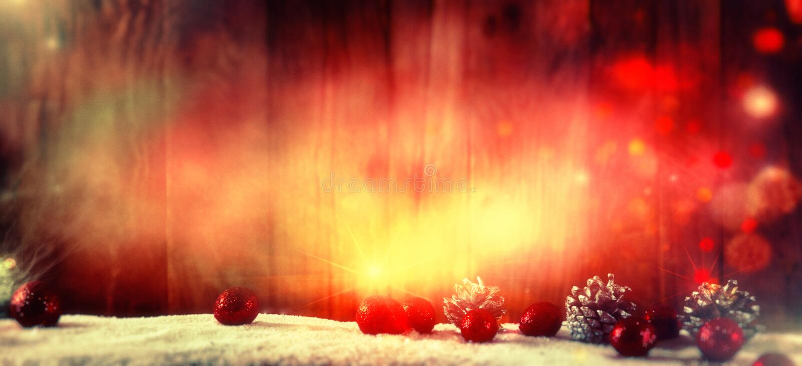 Christmas Background with Baubles and stars stock images
