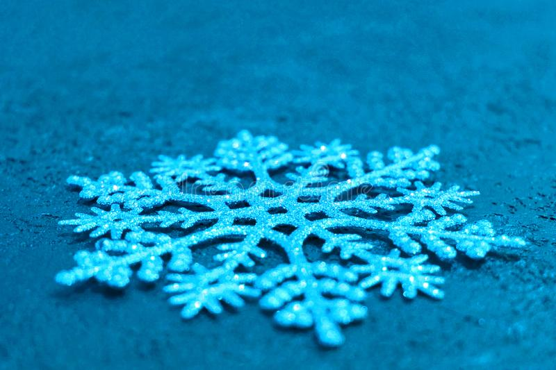 Christmas background. Big silver snowflake on a turquoise background. Copy space. Minimalistic design. Christmas background.silver snowflake on a turquoise royalty free stock photos