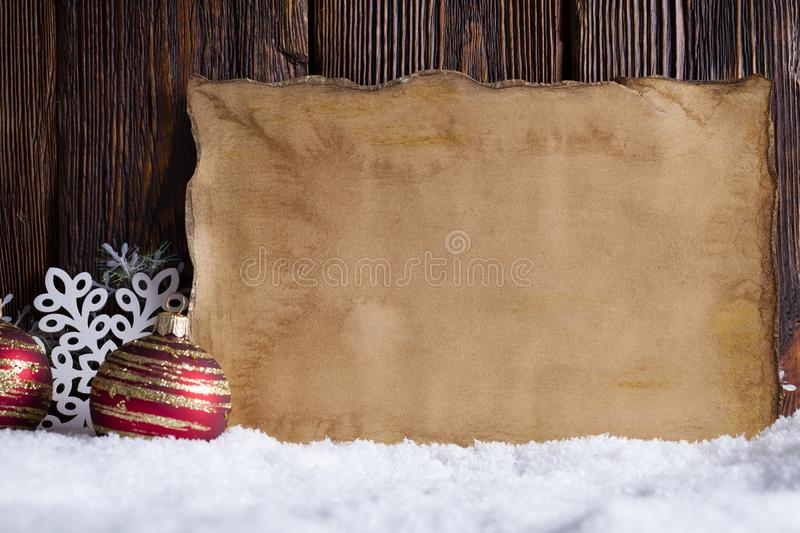 Christmas background - blank paper sheet, snowflakes and baubles stock photos