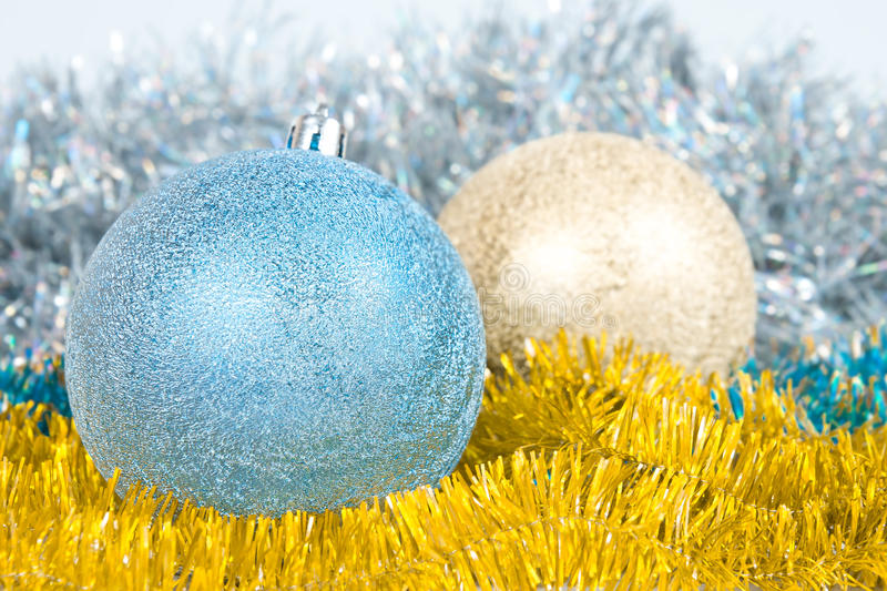 Christmas background with a blue and gold balls royalty free stock photos