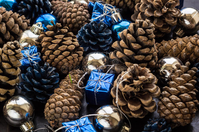 Christmas background with blue silver balls and pinecone. Christmas background with blue ornaments and snowy pinecone. Christmas party decoration with shiny royalty free stock photography