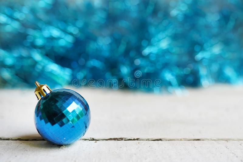 Christmas background with blue toy ball. Merry christmas greeting card. Winter holiday theme. Happy New Year. Space for text.  stock photography