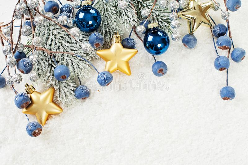 Christmas background border with corner composition made of green Xmas fir branch, blue berries and gold New Year decoration stock image