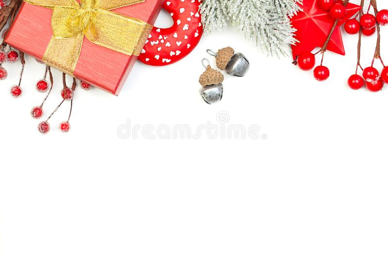 Christmas background border with green Xmas tree twig, gift and red New Year decoration.  royalty free stock photography