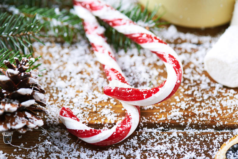 Christmas background of branches and candy canes stock photos
