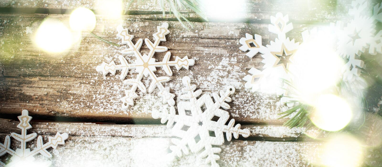 Christmas Background with Bright Glow and White Wooden Decorative Snowflakes. On Old Vintage Background, as Christmas Decor stock photos
