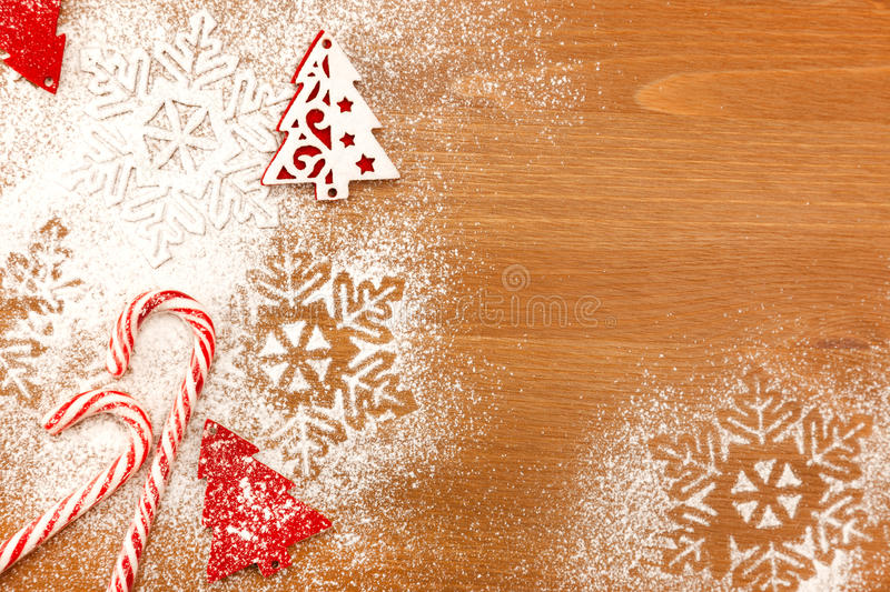 Christmas background with Candies, snowflakes and decorative Christmas Tree on wooden table royalty free stock photography