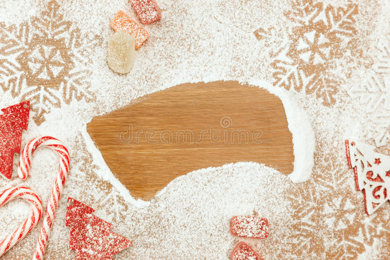 Christmas background with Candies, snowflakes on wooden table stock images