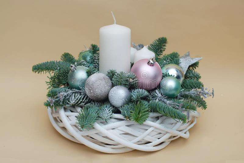 Christmas background with candles and decorations. Pink globes and fir branches stock image