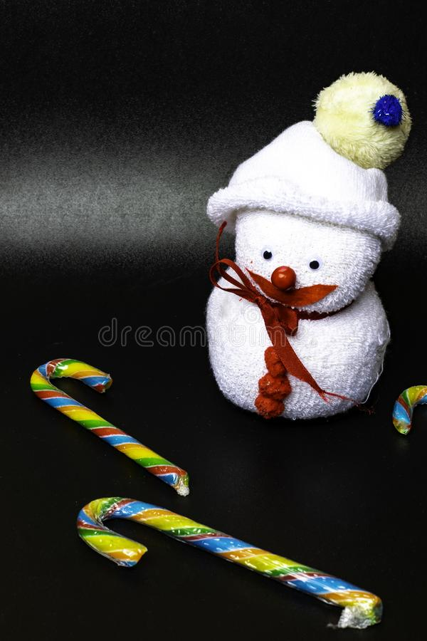 Christmas background, candy canes, snowman toy. Xmas greeting card stock photography