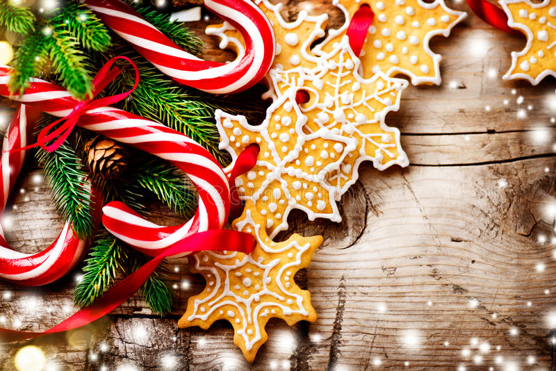 Christmas background with christmas cookies and candy canes. Christmas background with homemade christmas cookies and candy canes stock image