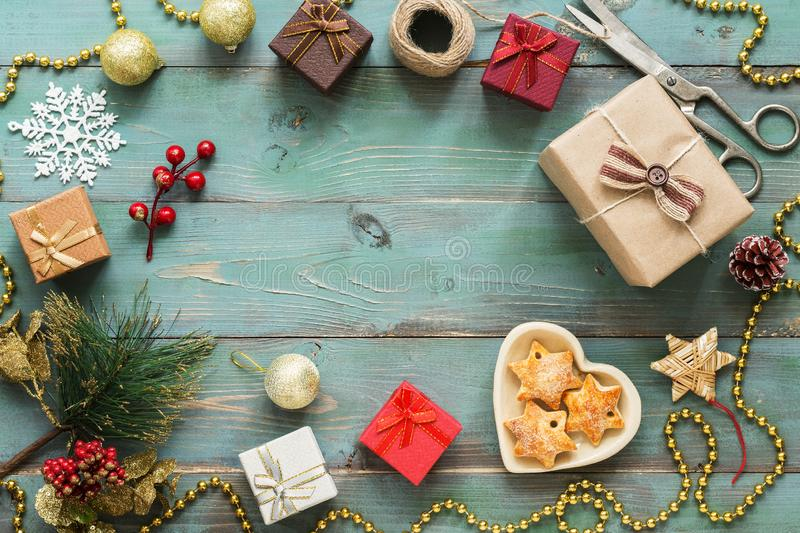Christmas background. Christmas gift with christmas decorations on the wooden rustic green table. Top view, copy space. Flat lay royalty free stock photography