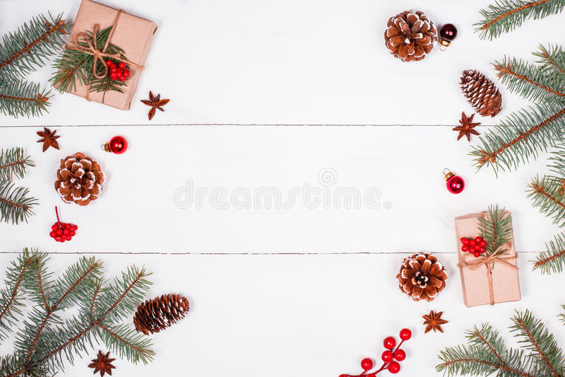 Christmas background with Christmas gift, fir branches, pine cones, snowflakes, red decorations. Xmas and Happy New Year. Composition. Place for text. Flat lay stock photos