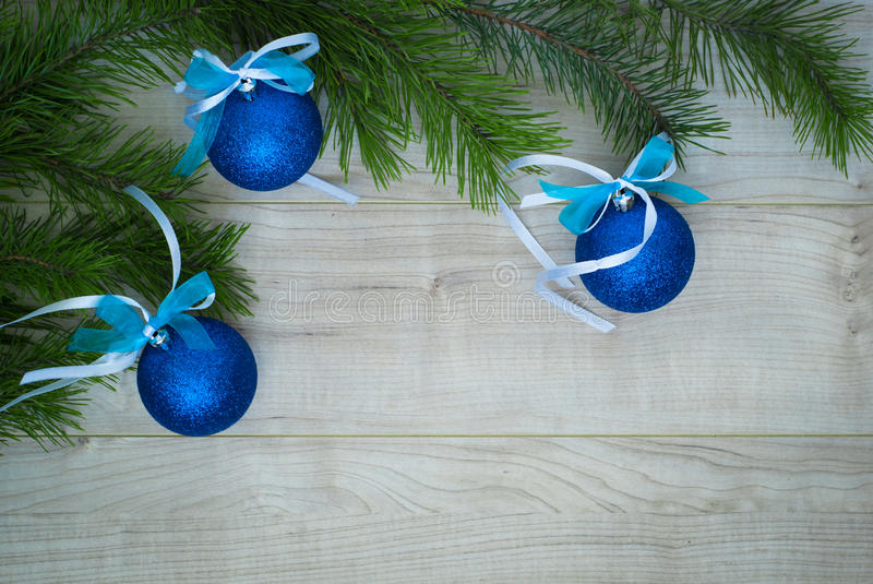 Christmas background with Christmas tree branch and blue balls royalty free stock images