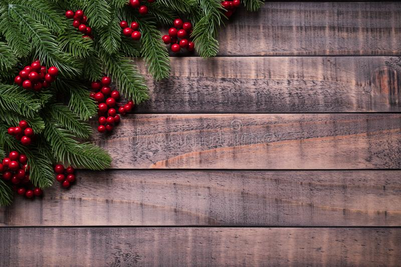 Christmas background concept.op view of Christmas spruce branches, pine cones, red berries. Christmas background concept. Top view of Christmas gift box red sock stock photography
