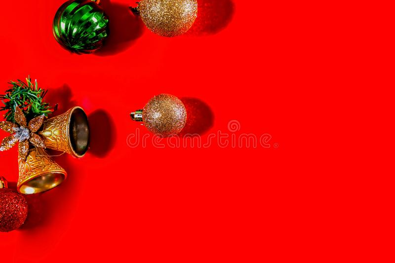 Christmas background concept. Top view of Christmas golden bells with balls decoration, spruce branches, star and snowflakes on re. D background. Flat lay, top royalty free stock image