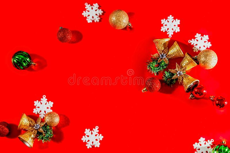 Christmas background concept. Top view of Christmas golden bells with balls decoration, spruce branches, star and snowflakes on re. D background. Flat lay, top royalty free stock images