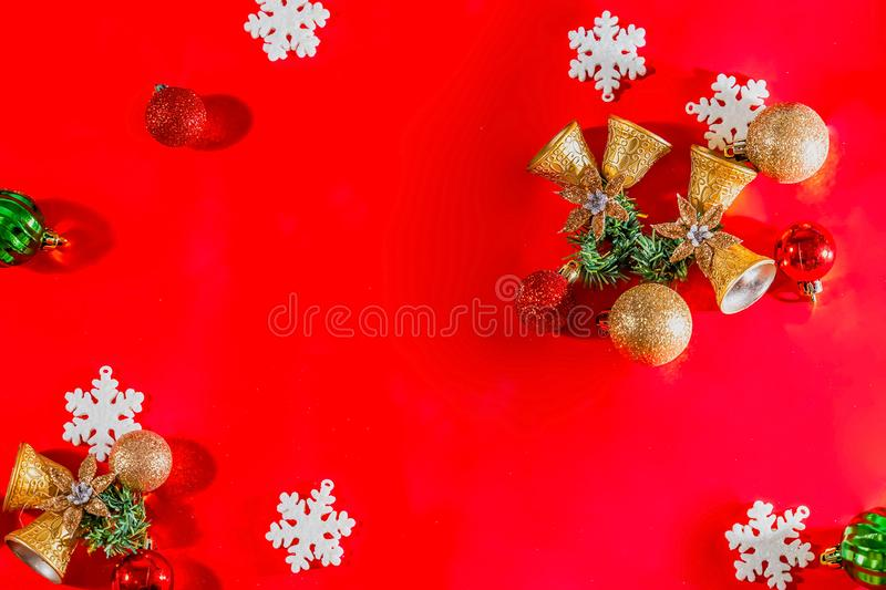 Christmas background concept. Top view of Christmas golden bells with balls decoration, spruce branches, star and snowflakes on re. D background. Flat lay, top royalty free stock photography