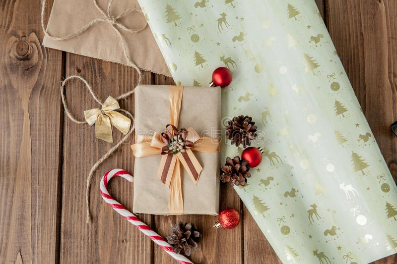 Christmas background with Christmas cones and toys, fir branches, giftboxes and decorations on a wooden table background.  royalty free stock images
