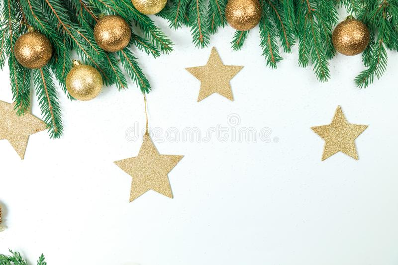 Christmas background for a congratulatory inscription. Green Branches if frame . It is decorated by New Year`s g stock photography